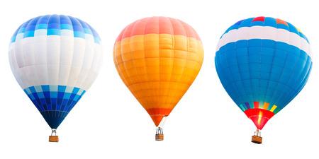 fluga: Färgglada varmluftsballonger isolerade över vita