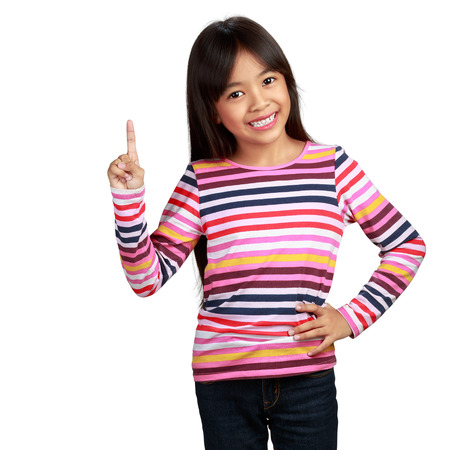 Little asian girl standing with index finger up Imagens