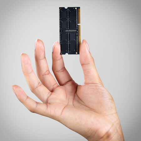ddr3: Hand holding computer memory DDR3  Stock Photo