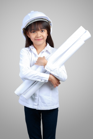 Little Engineer, Little girl in the construction helmet with a poster Stock Photo - 23662946