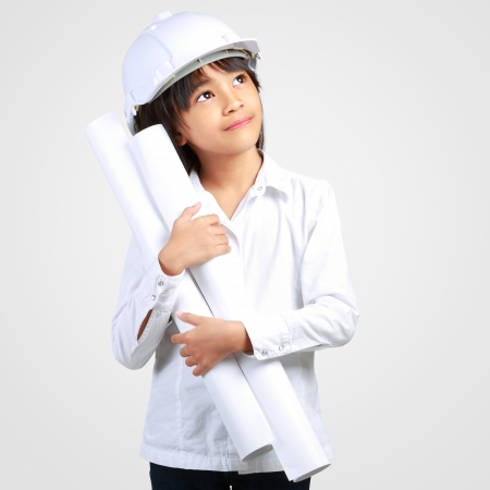 Little Engineer, Little girl in the construction helmet with a poster  Stock Photo - 23662947