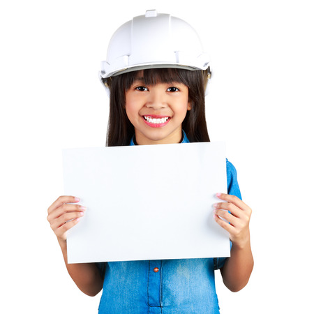 Young smiling asian girl in a building helmet holding a sheet of paper in a hand, Isolation over white with clipping path Stock Photo - 23727854