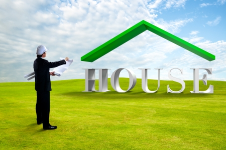 back view man: Standing engineer looking house 3D on green grass