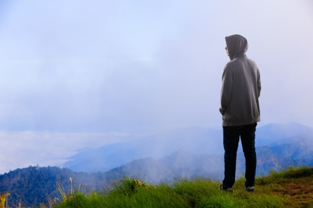 Teenager asian boy standing at mountain, Outdoor portrait photo