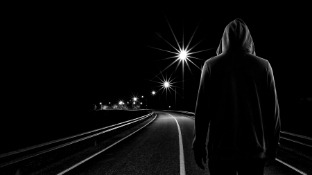 standing alone: Teenager boy standing alone in the street at night, Black   White tone