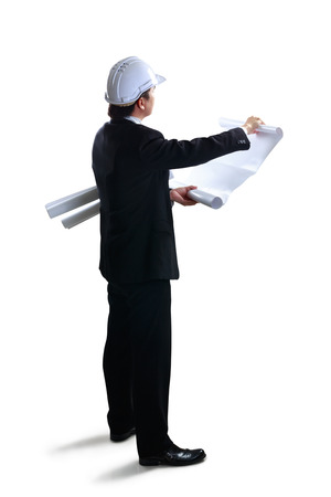 Architect looking at blueprints, Isolated over white with clipping path photo