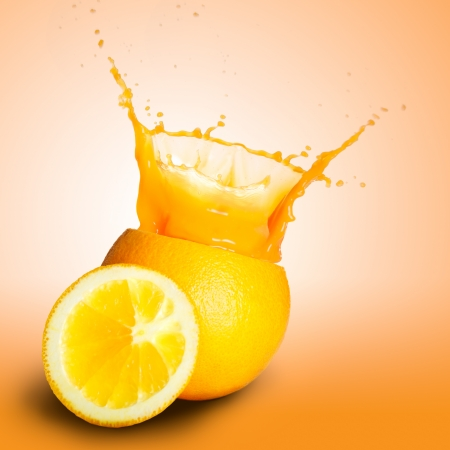 Orange juice splashing photo