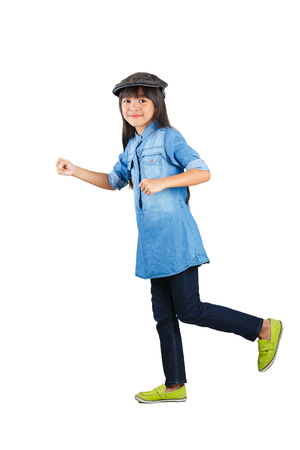 Smiling asian little girl in the action of walking, Isolated over white with clipping path photo