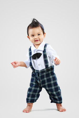 Happy toddler learning to walk Stock Photo