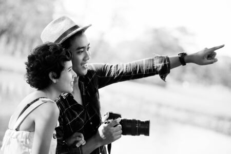 Happy asian couple tourists in nature, Black   White photo