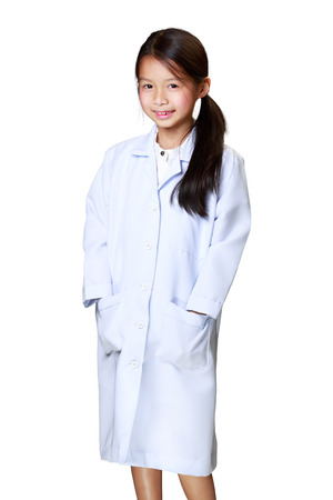 Cute little asian girl dressed like a doctor, Isoated over white photo