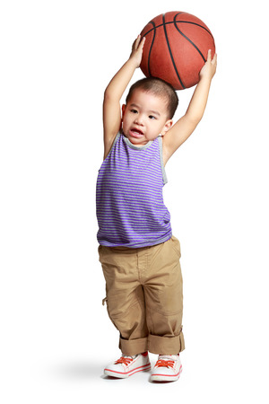 Little boy with basketball, Isolated over white photo