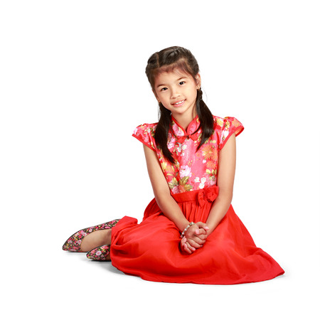 chinese dress: Little asian girl in traditional chinese cheongsam dress Stock Photo