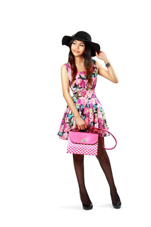 Asian girl with bag posing on white background photo
