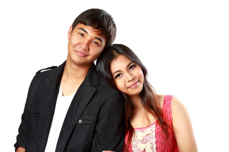 young couple smiling: Closeup smiling asian couple in love, Isolated over white Stock Photo