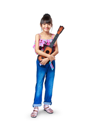 Young asian girl with ukulele, Isolated over white photo