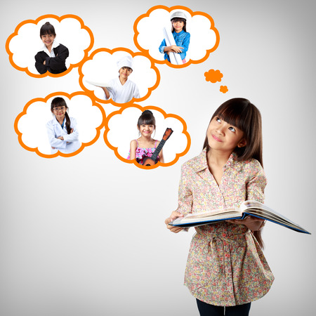 thinking bubble: Little asian girl thinking of future education career choice options student
