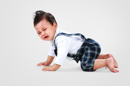 Asian baby boy lay down to crying photo