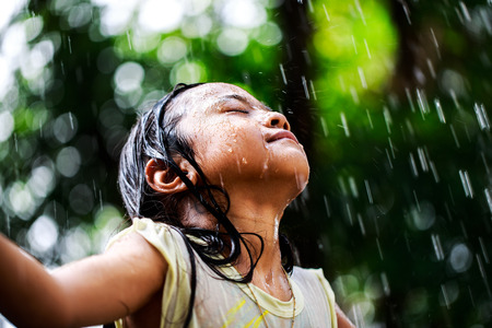 downpour: Closeup little girl in the summer rain Stock Photo