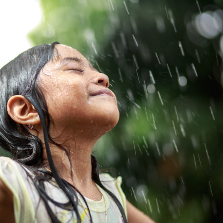 Closeup little girl in the summer rain Stock Photo
