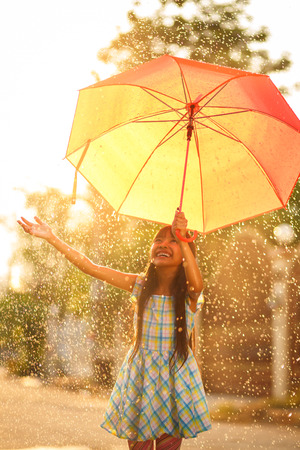 Pretty young asian girl in the rain with umbrella Stock fotó