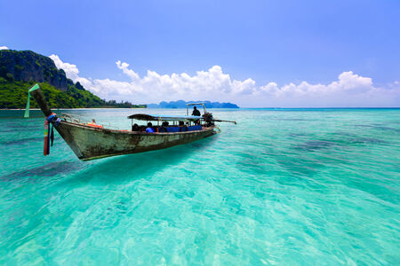 Wooden boat and blue water ocean, Krabi Thailand photo