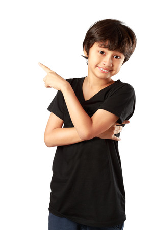 Happy asian boy pointing up, Isolated over white Фото со стока