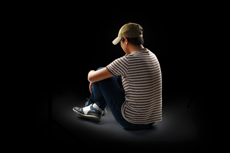 alone: Teenage boy sitting alone