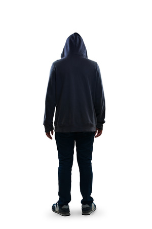 Sad teenage boy standing rear view, Isolated over white photo