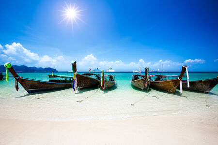 Longtale boat at the beach, Krabi Thailand photo