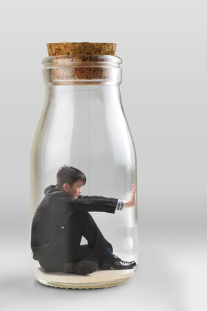pent: Young businessman trapped in a glass jar