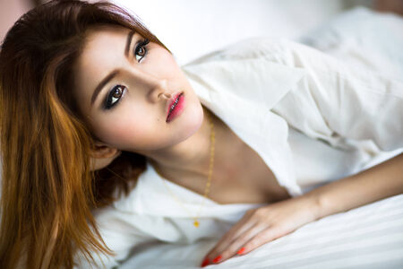 sexy asian woman: Closeup young asian woman lying on the bed Stock Photo