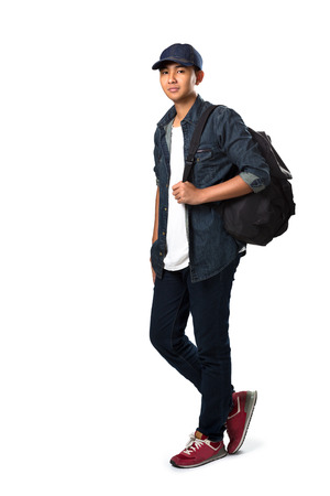 full length portrait: Relaxing young asian teenager boy standing, Isolated over white