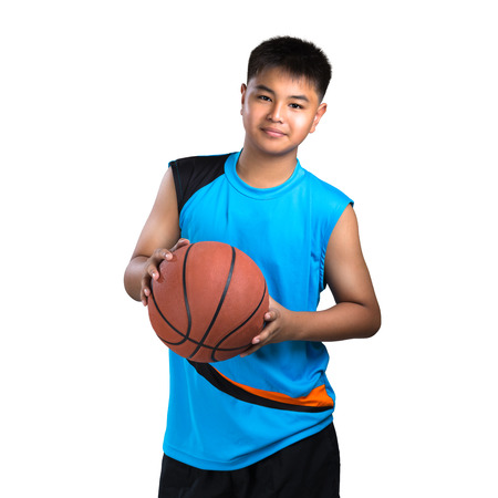 Teenager boy playing with basket ball, Isolated over white