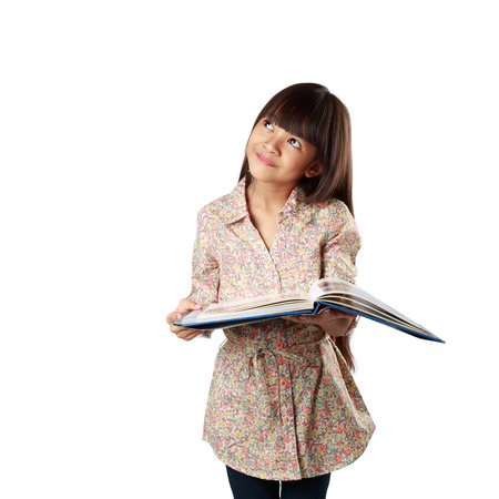 Little asian girl with textbook, Isolated over white Фото со стока