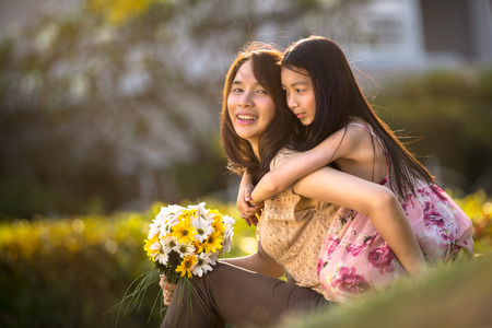 Happy young mother with her daughter at park Stock Photo