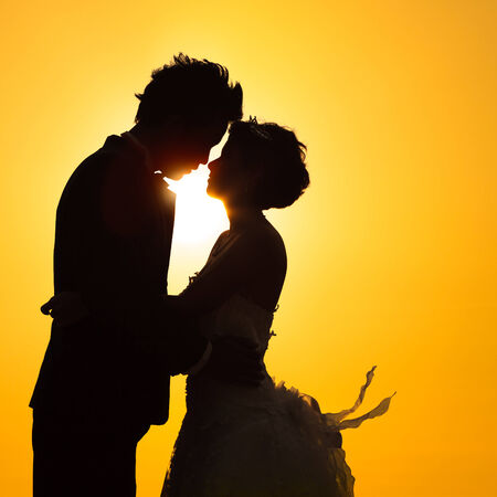 Silhouette couple love with sunset photo