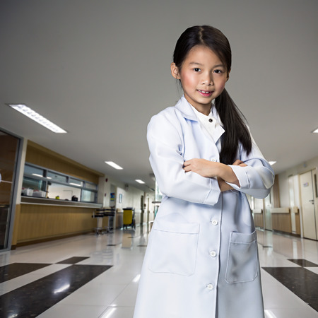 dressup: Young asian girl dressup as a doctor standing in hospital