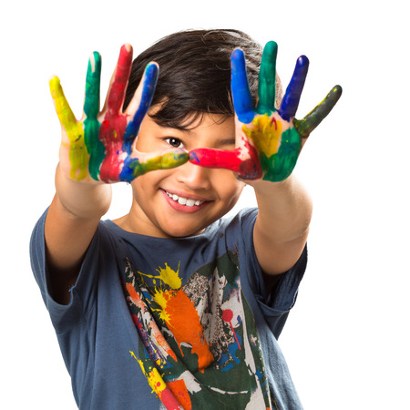 Lttle asian boy with hands painted in colorful paints, Isolated over white