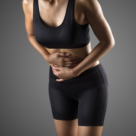abdominal: Closeup stomach pain or menstrual pain woman with pains in abdomen female belly and hands Stock Photo