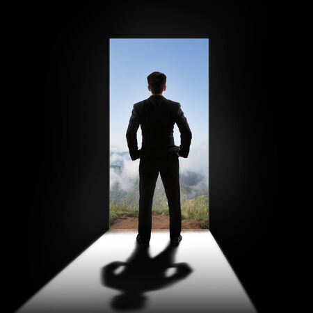 view of a wooden doorway: Businessman at the door Stock Photo