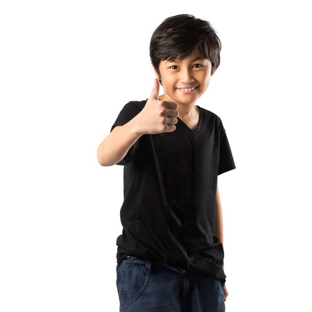 Happy asian boy showing thumb up, Isolated over white photo
