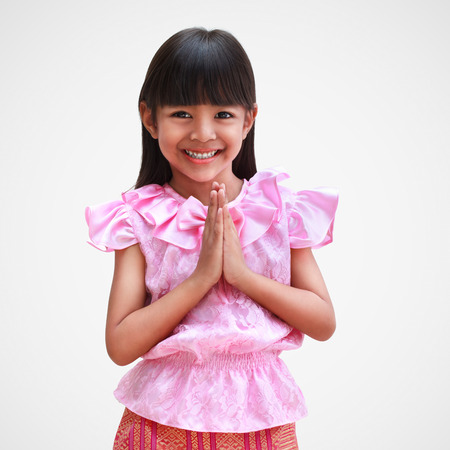 Little thai girl welcome expression sawasdee, Isolated on grey background photo