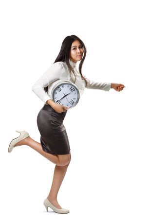 Business woman running and holding a clock, Isolated over white photo