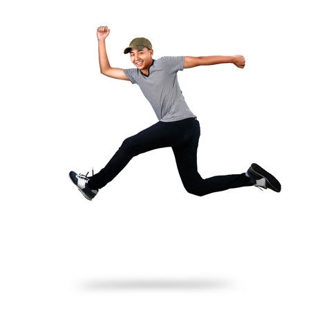 success asian: Asian teenager jumping, Isolated over white Stock Photo