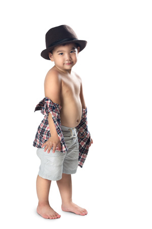Adorable little asian boy posing, Isolated over white photo