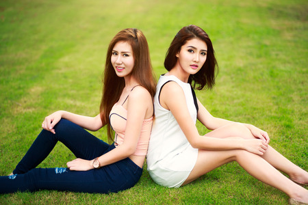 thai teen: Two young asian women in park having good time Stock Photo
