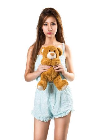 toy bear: Teenage girl holding her teddybear, isolated over white Stock Photo