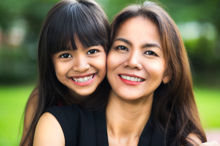 mother: Happy mother and child girl, Outdoor Stock Photo