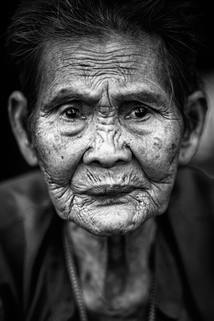 Close up face of old asian woman with wrinkles elderly senior, Black & White color tone